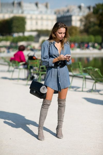 blue long-sleeved chambray shirt dress with over-the-knee boots