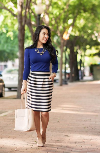 blue long-sleeved t-shirt black and white striped pencil skirt