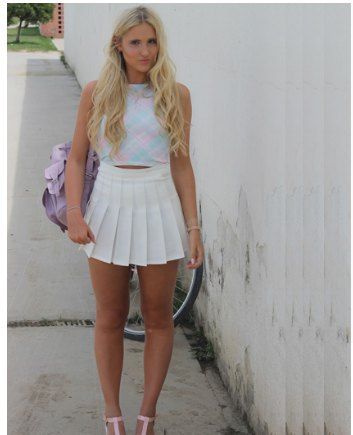 short top with blue stand-up collar and white mini pleated skirt