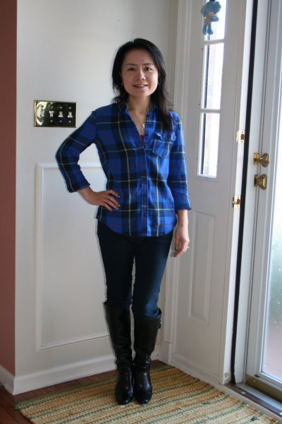 blue plaid shirt with dark skinny jeans and knee-high boots