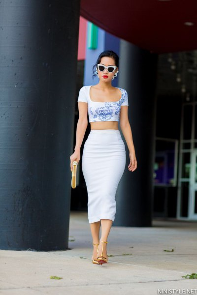 Blue printed, short cut, figure-hugging T-shirt with a high-waisted white skirt