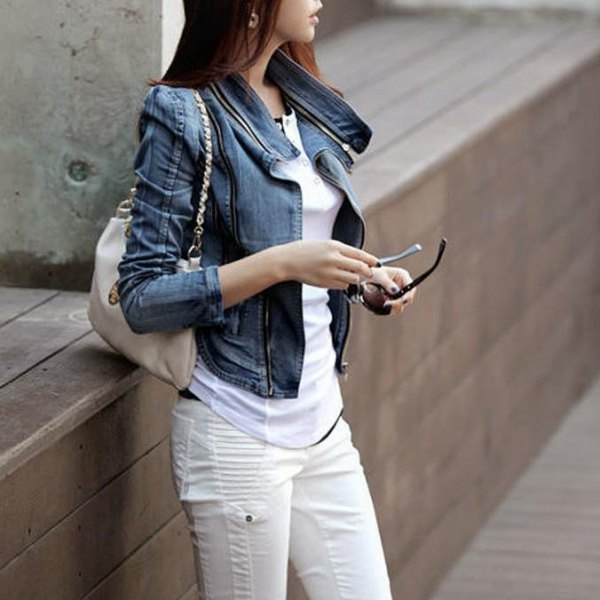 blue denim jacket with puffed shoulders and white moto jeans