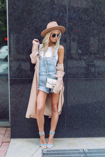 blue romper suit with a long blush coat and jeans heels