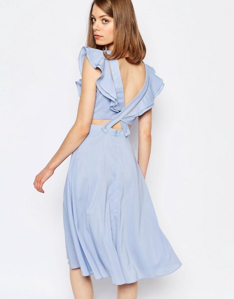 blue two-piece dress with ruffle sleeves and low back