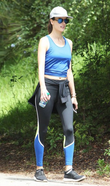 short tank top with blue scoop neckline and running shorts