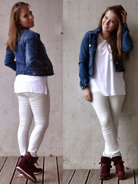 blue, cropped denim jacket with white tunic top and black sneakers with hidden wedges