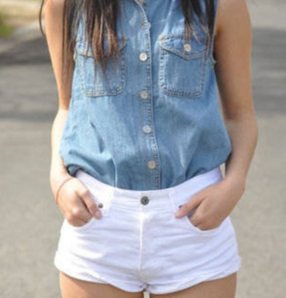blue sleeveless chambray shirt with buttons and white shorts