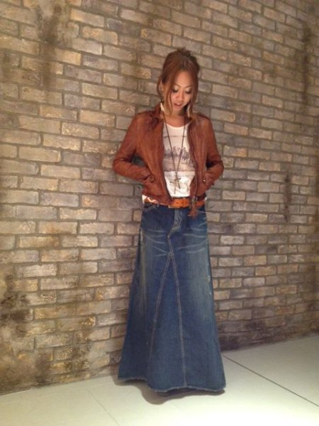 blue, slightly flared maxi denim skirt with brown leather jacket
