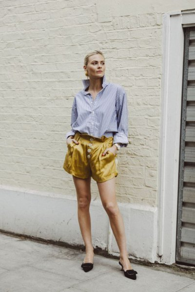 blue striped shirt with buttons and yellow, flowing shorts