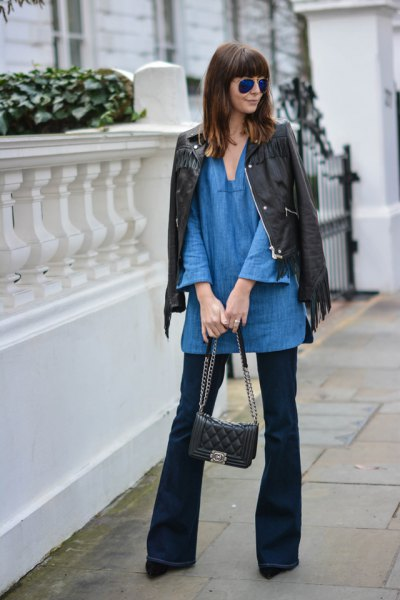 blue tunic with V-neck with black leather jacket and flared jeans