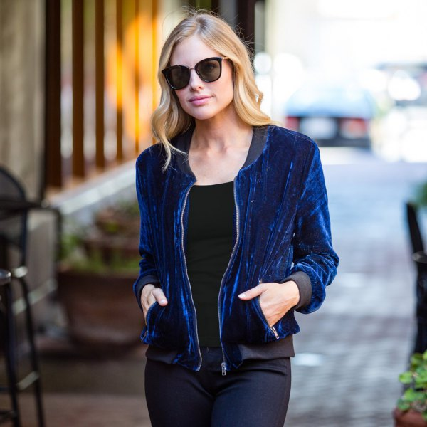 blue velvet bomber jacket with white t-shirt and skinny jeans
