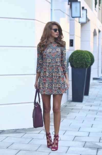 blushing and black, long-sleeved chiffon shift mini dress with a floral pattern and cut out plaid heels