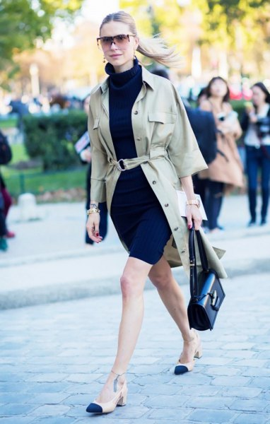 Blushing khaki jacket with belt, black mini dress with stand-up collar and low heels