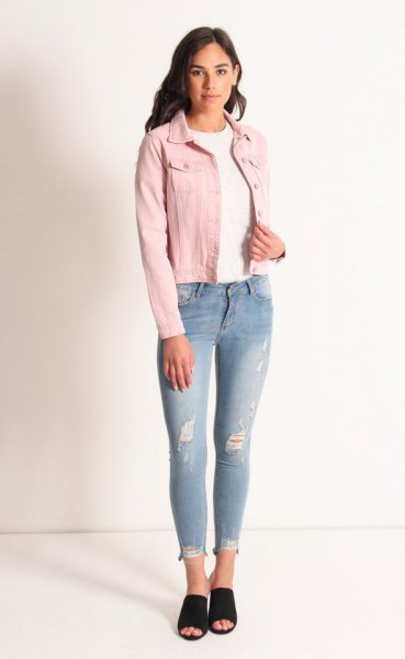 Rouge denim jacket with a white crew neck sweater and light blue jeans