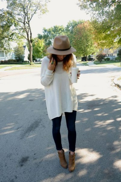 Rouge hat with white oversized sweater and camel suede ankle boots