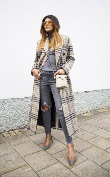 Blushing pink and black maxi checked coat with gray, torn knee jeans