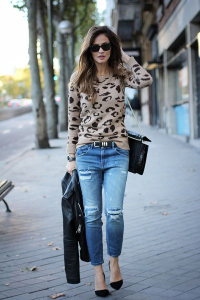 Blush pink and black printed sweaters with jeans and suede heels