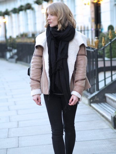 blushing pink aviator jacket with black sweater and knitted scarf