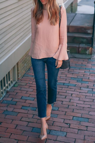 blushing pink chiffon blouse with bell sleeves and blue skinny jeans