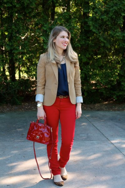 blushing pink blazer with navy blouse and red belt