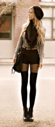 blushing pink blouse with black scarf and matching mini-shorts