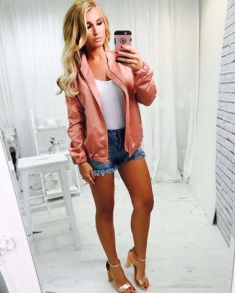 blushing pink bomber jacket with white tank top and gold sandal heels