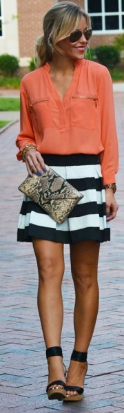 Blush pink buttoned shirt with black and white striped mini pleated skirt
