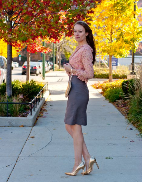 blushing pink chiffon blouse with a gray knee-length skirt and gold heels