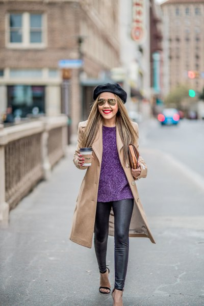 Blushing pink coat with a dark blue sweater and black leather gaiters