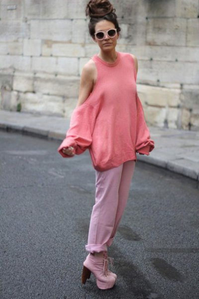 Blushing pink cold shoulder sweater with white jeans with cuffs and platform heels