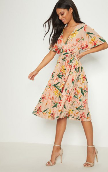 blush pink deep v-neck pleated chiffon dress with floral print and open toe heels