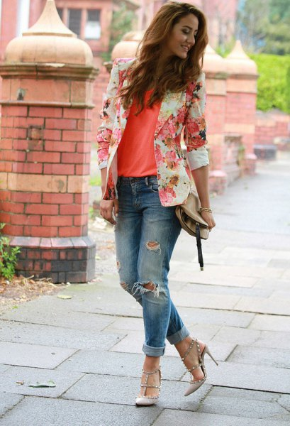 blushing pink floral blazer with an orange tank top and ripped jeans