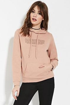 blush pink graphic sweater with black skinny jeans and choker