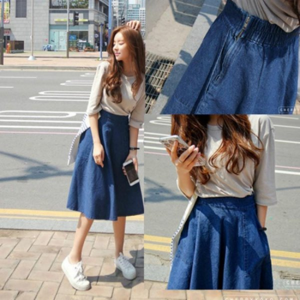 blushing pink t-shirt with half sleeves and a blue, unwashed, flared denim skirt