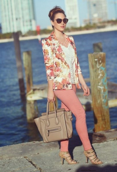 blushing pink jacket with white ruffled top and crepe skinny jeans