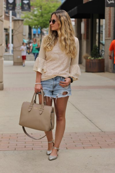 blushing pink lace blouse with bell sleeves and light blue, ripped denim shorts