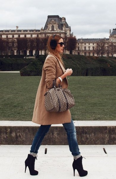 Blushing pink long woolen coat with feathered skinny jeans and ankle boots with heels