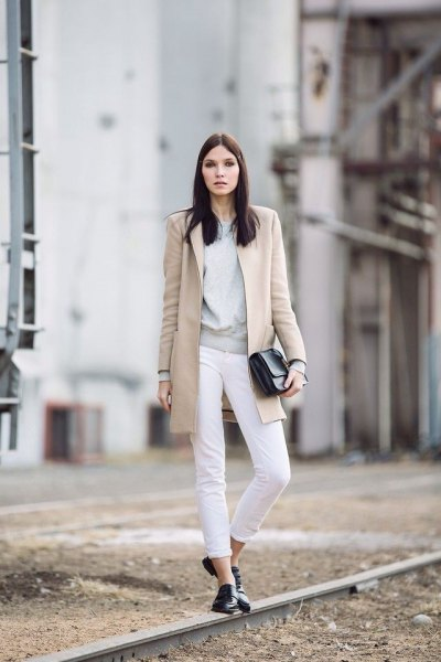 Blush pink long wool coat with white cuffed jeans