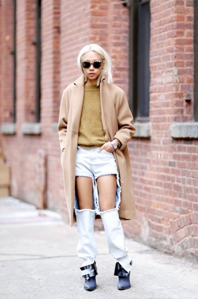 Blush pink long wool coat with super ripped white jeans