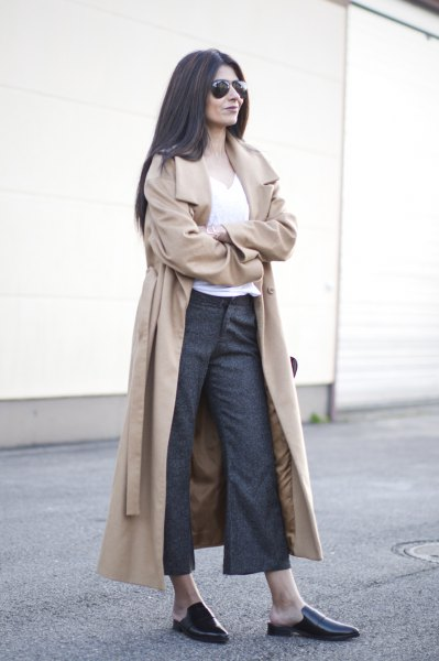 blushing pink longline trench coat with belt and gray, flared chinos and slippers