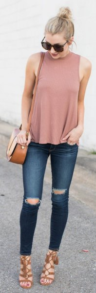 blushing pink tank top with stand-up collar and dark blue jeans
