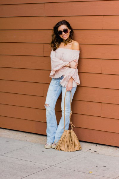 blush pink strapless blouse flared jeans