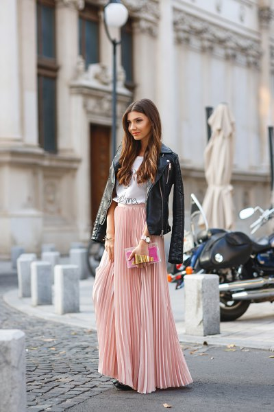 blushing pink pleated skirt with black leather jacket