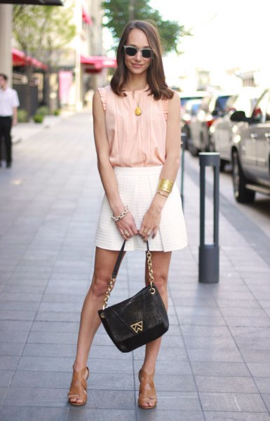 Blush the sleeveless chiffon top with pink pleats and minirater skirt