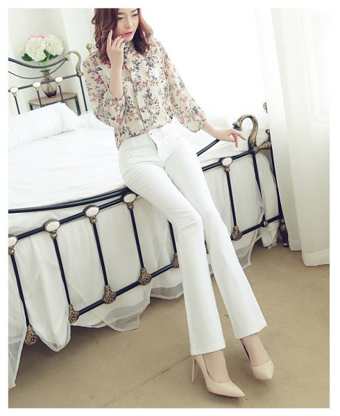 blush pink printed button up shirt with white jeans