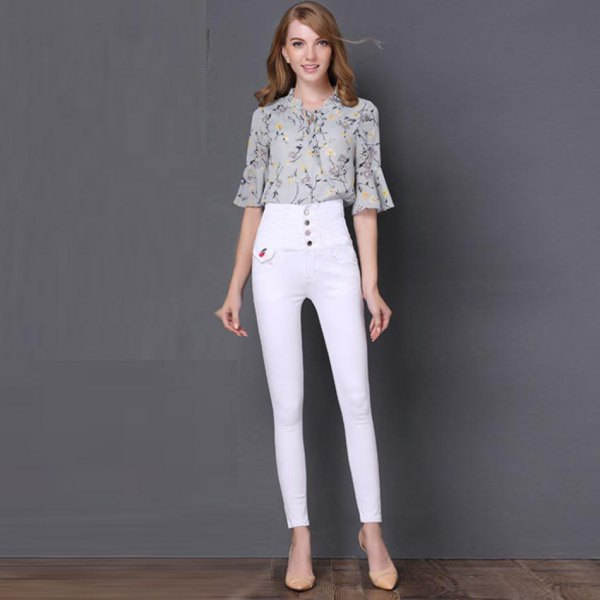Blush pink printed chiffon bell-sleeved blouse with white button placket and high-waisted jeans