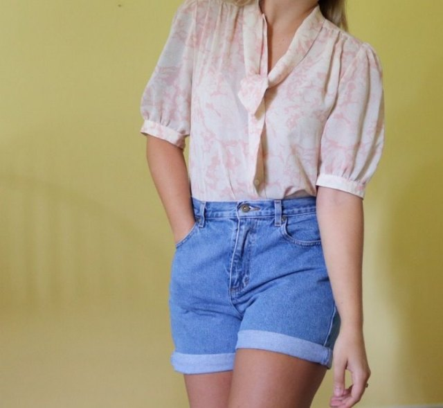 blushing pink puff sleeve blouse with high-waisted jeans