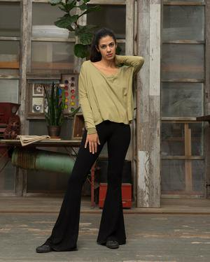 Blush pink long t-shirt with relaxed fit and black flared pants