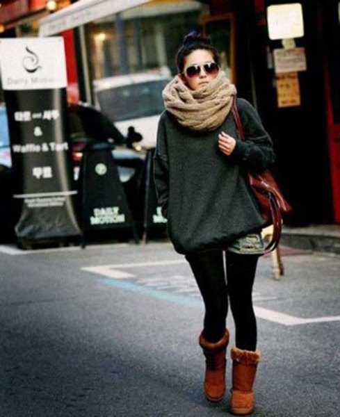 Blushing pink scarf with a gray sweater and black skinny jeans