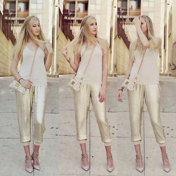 blushing pink tank top with a scoop neckline and gold sequined jogger pants